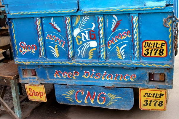 Many trucks have paintings like this on their rears asking people to honk, as a safety precaution