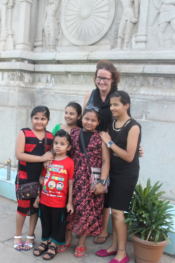 A photo of some children who asked for my name when we were on land, and then cheerfully called out to me when we reached the Buddha statue in the middle of a lake in Hyderabad, requesting a photo